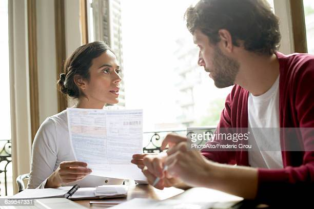 Couple discussing family financial issues