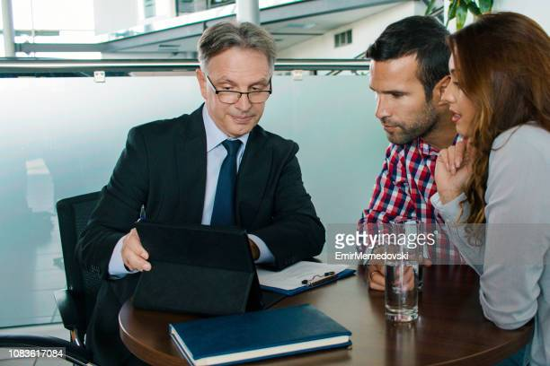 couple discussing investment plan with financial advisor - bank manager stock pictures, royalty-free photos & images