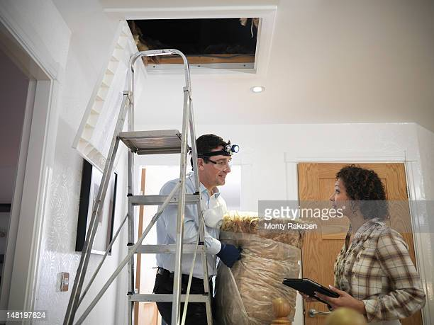 Couple discussing loft insulation in home