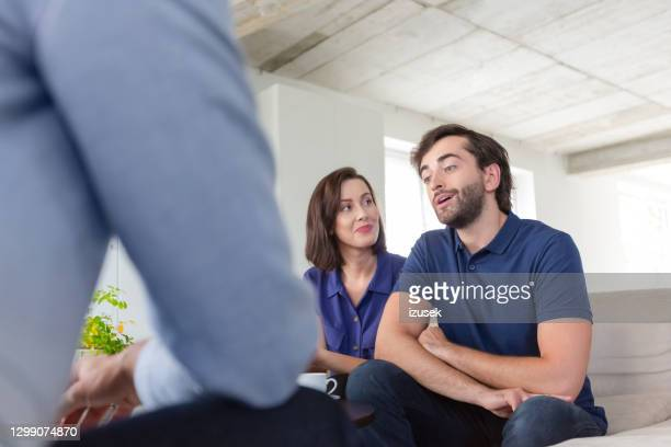 couple discussing problems with psychotherapist - conflict stock pictures, royalty-free photos & images