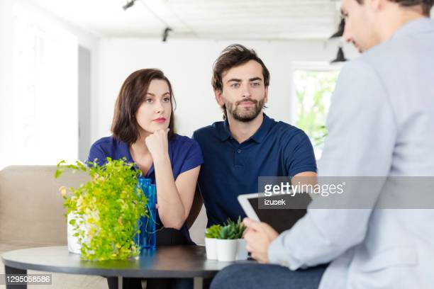couple discussing with financial advisor - izusek stock pictures, royalty-free photos & images