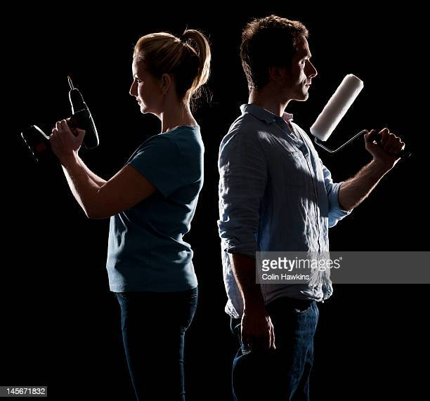 couple diy duel - colin hawkins stock pictures, royalty-free photos & images