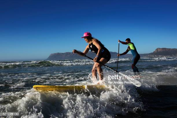 A couple does stand up paddle boarding in Muizenberg beach outside Cape Town South Africa Cape Town has become one of the worlds must see cities with...