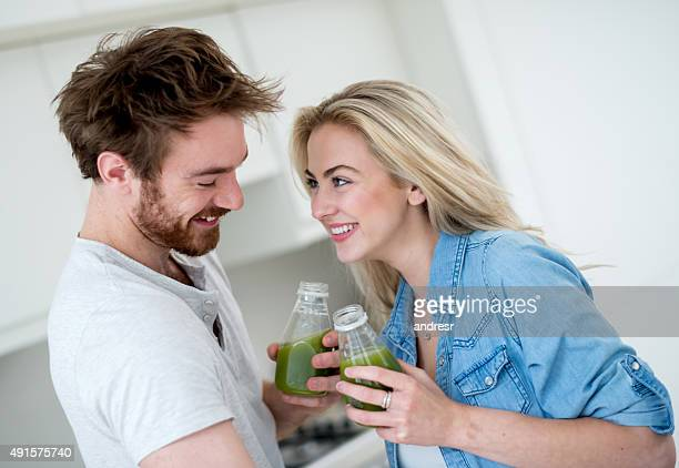 Couple doing a cleansing drinking organic juices