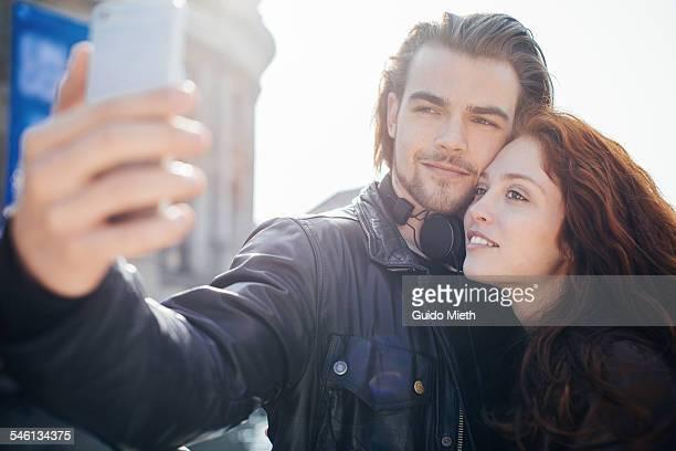 Couple doing a selfie outdoor.