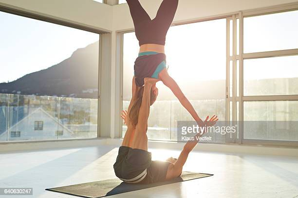 Couple doing acrobatic yoga