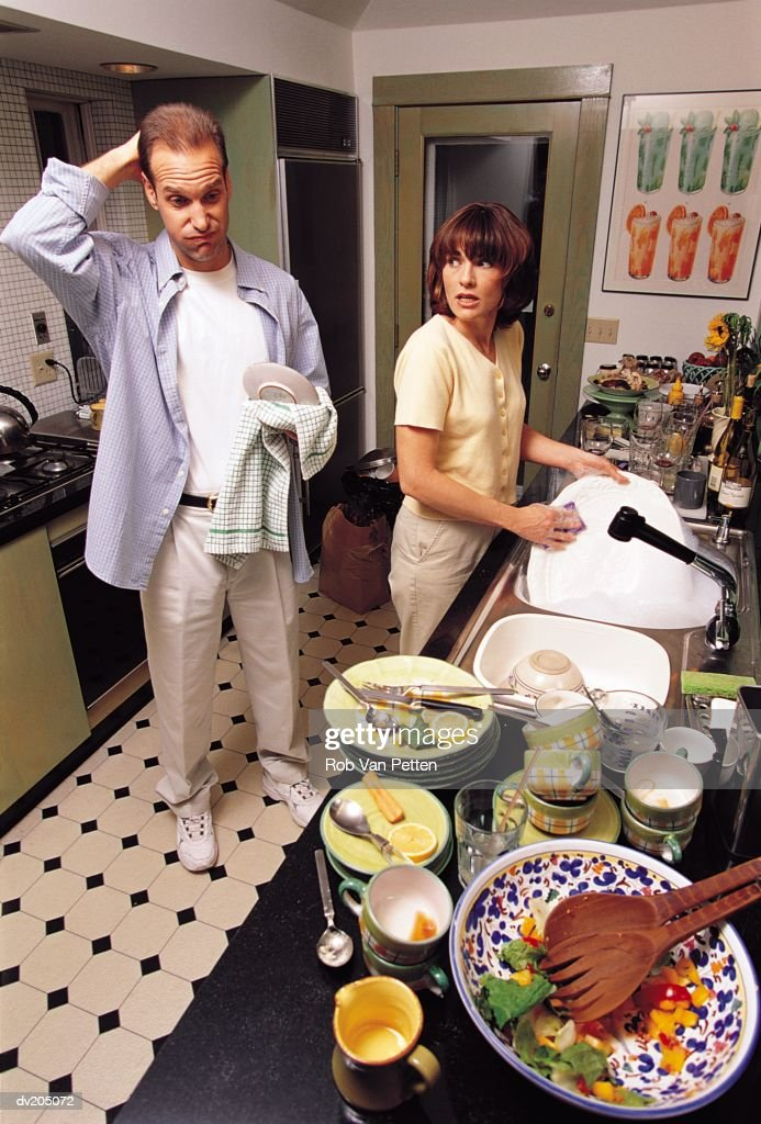 Couple doing dishes in kitchen : Stock Photo