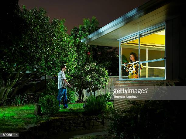 Couple doing domestic chores at