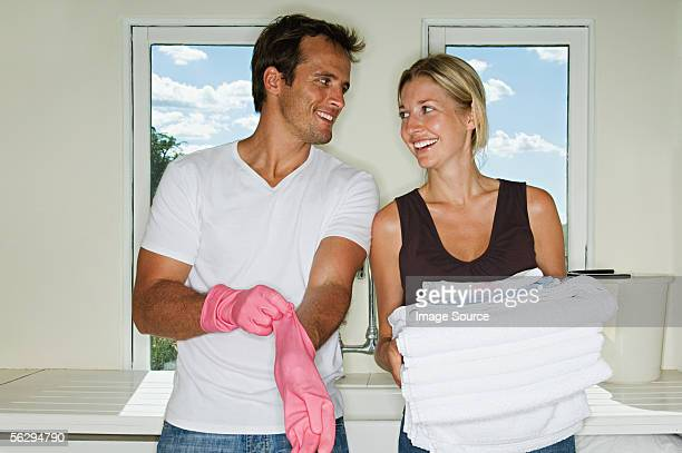 couple doing housework - chores stock photos and pictures