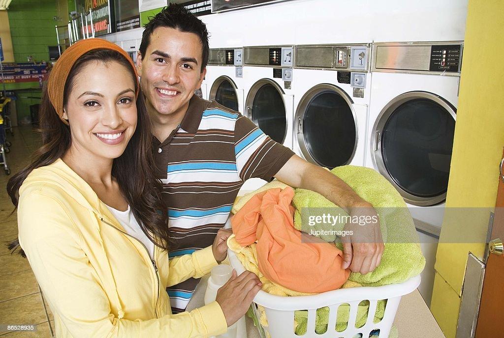 Couple doing laundry : Stock Photo