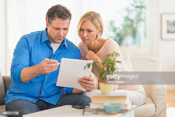 Couple doing paperwork at home