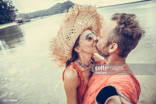 couple doing selfie photo on the beach