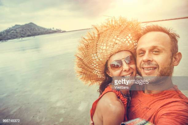 couple doing selfie photo on the beach