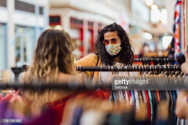 couple doing some retail therapy - design stock pictures, royalty-free photos & images