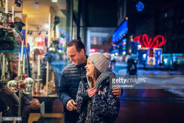 couple doing some window shopping - boxing day stock pictures, royalty-free photos & images