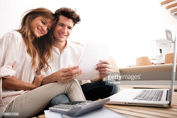 Couple doing their domestic finances in living room.