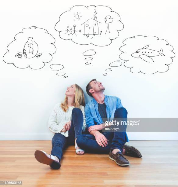 couple dreaming of family, wealth and travel. - dreaming stock pictures, royalty-free photos & images