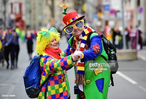 A couple dressed as clowns dance at the annual Rose Monday parade on February 27 2017 in Mainz Germany Political satire is a traditional cornerstone...