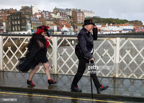 A couple dressed as Goth battle strong winds as they attend Whitby Goth Weekend on October 27 2018 in Whitby England The Whitby Goth weekend began in...