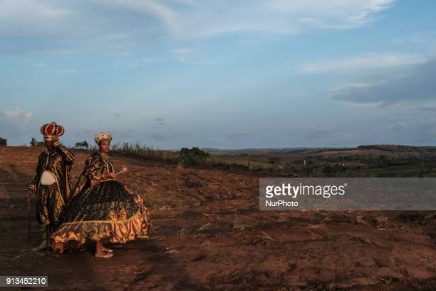 A couple dressed as king and queen are seen in a cane field as they await the beginning of a presentation of Maracatu in the city of Nazaré da Mata...