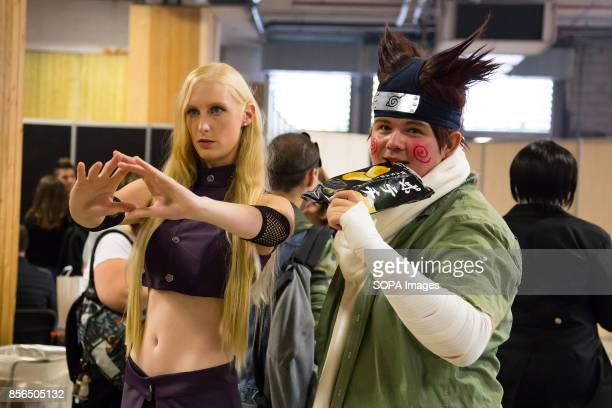 A couple dressed as manga characters are pictured during the 24th edition of the Paris Manga SciFi Show mostly devoted to Japanese entertainment and...