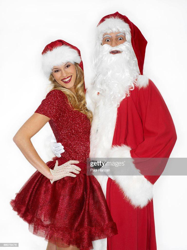 Couple Dressed As Santa Claus And Mrs Claus Stock Photo
