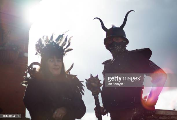 A couple dressed as steam punk goths stand outside a pub during Whitby Goth Weekend on October 28 2018 in Whitby England Whitby Goth weekend began in...