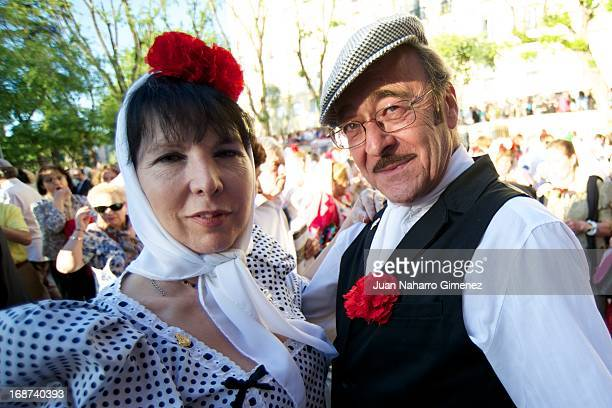 A couple dressed in chulapo look on during the festivities on May 14 2013 in Madrid Spain These festivities are in honor of San Isidro Labrador and...