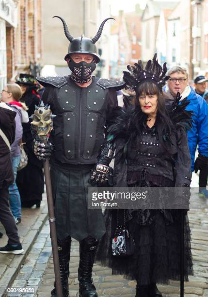 A couple dressed in extravagant steam punk clothing walk through town during Whitby Goth Weekend on October 28 2018 in Whitby England Whitby Goth...