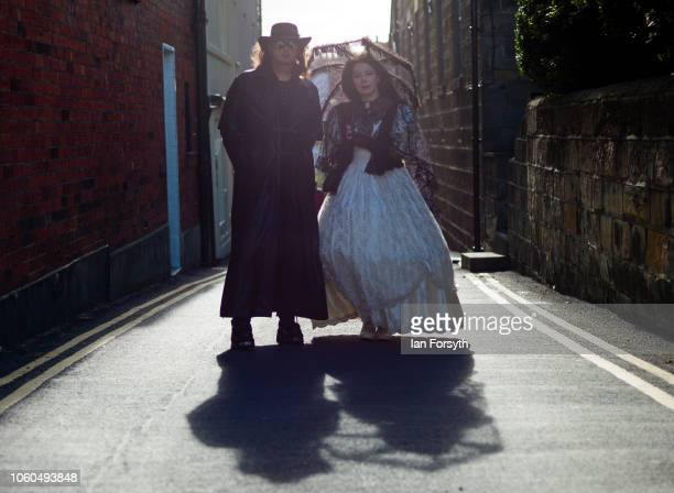 A couple dressed in goth clothing pose for a photograph during Whitby Goth Weekend on October 28 2018 in Whitby England Whitby Goth weekend began in...
