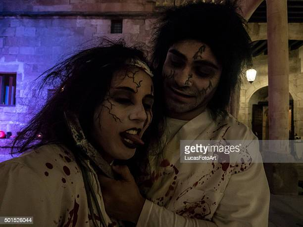 couple dressed in halloween - devil costume stock photos and pictures