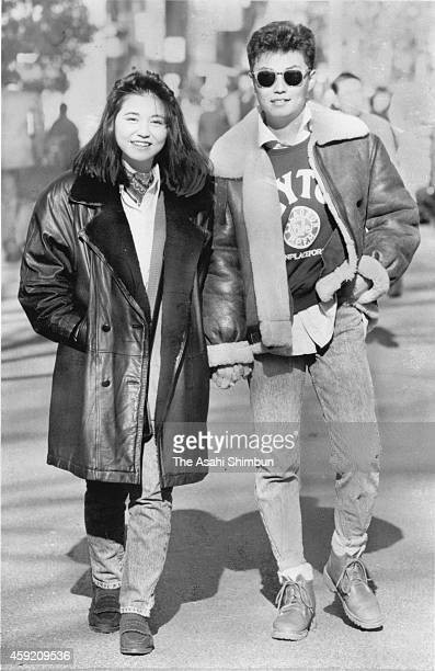 A couple dressed in 'ShibuKaji' or casual fashion popular in Shibuya on unspecified date in January 1989 in Shibuya Tokyo Japan