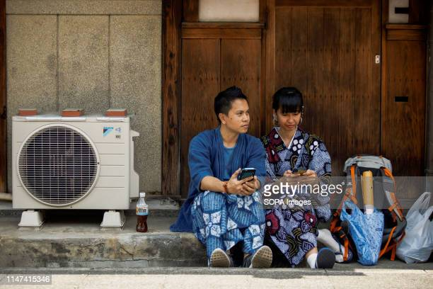 ARIMATSU NAGOYA AICHI JAPAN A couple dressed in traditional Yukata costumes during the Arimatsu Shibori Festival Thirty young successors showed the...