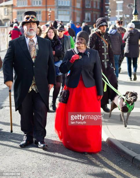 A couple dressed in Victoriana clothing walk through town during Whitby Goth Weekend on October 28 2018 in Whitby England Whitby Goth weekend began...
