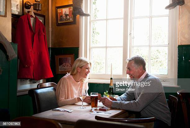 Couple drinking and chatting in pub
