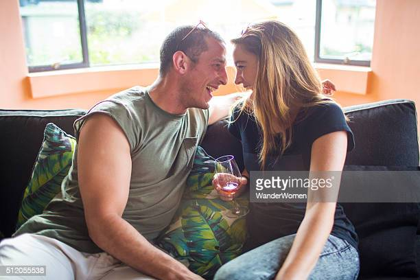 couple drinking and laughing about to kiss with wine - tinder stock pictures, royalty-free photos & images