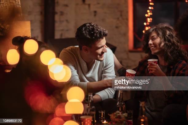 Couple drinking and talking at the party