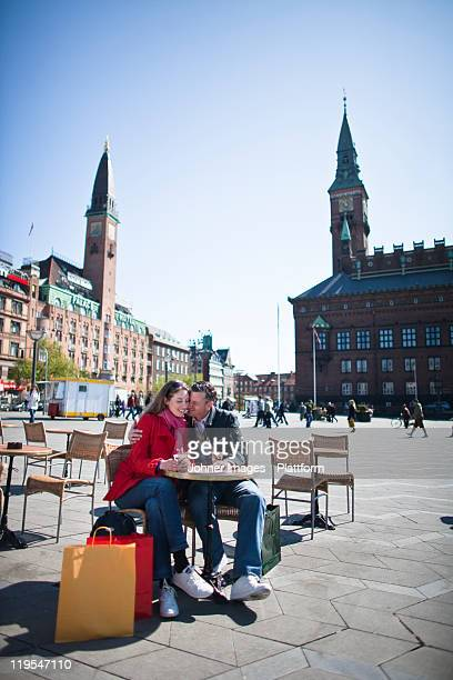 Couple drinking at outdoor cafe in city