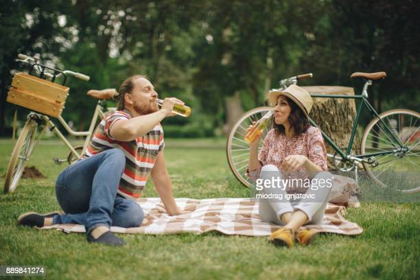 Couple drinking beer on a picnic