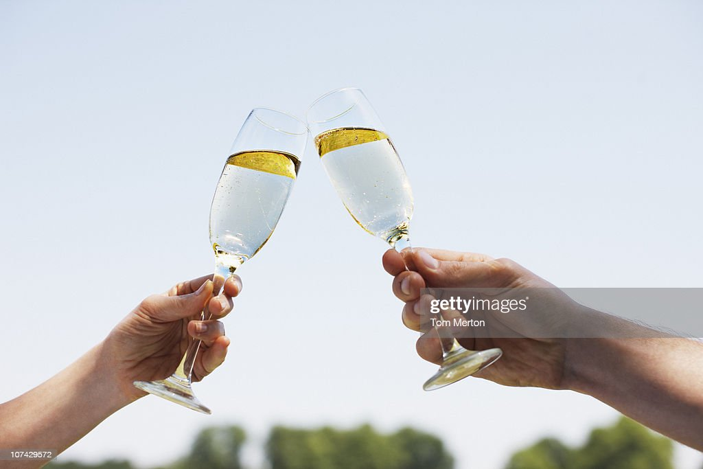 Couple drinking Champagne and toasting : Stock Photo