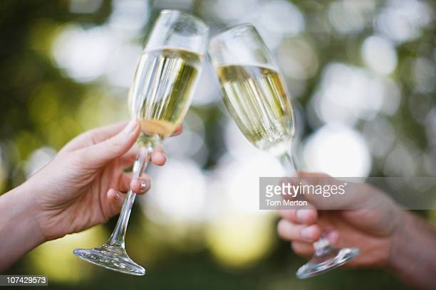 couple drinking champagne and toasting - bonding stock pictures, royalty-free photos & images