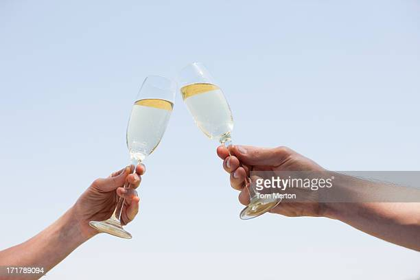 couple drinking champagne and toasting - champagne stock pictures, royalty-free photos & images