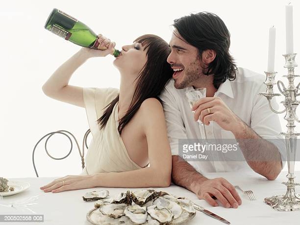 Couple drinking champagne at table