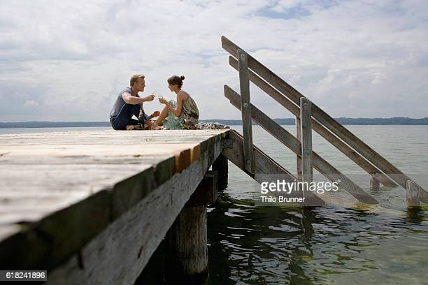 Couple Drinking Champagne on Pier