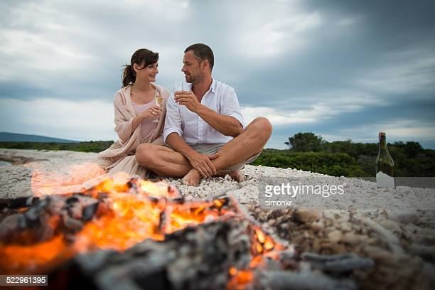 Couple Drinking Champagne On The Beach