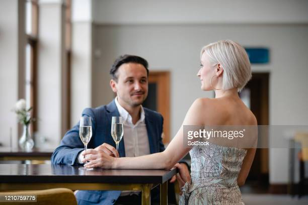 couple drinking champagne together on date - strapless stock pictures, royalty-free photos & images