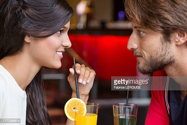 Couple drinking cocktail in a restaurant