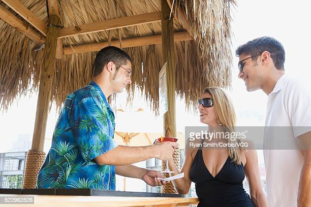 couple drinking cocktails at a rooftop bar - 胸の谷間 ストックフォトと画像
