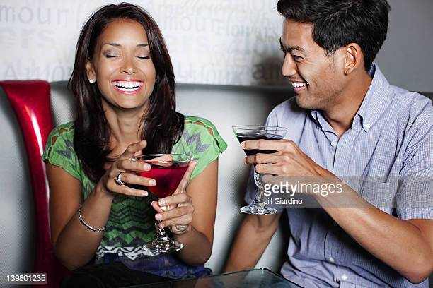 Couple drinking cocktails in nightclub