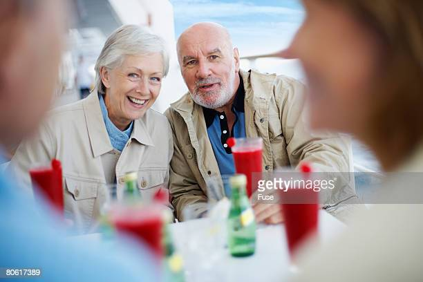 Couple Drinking Cocktails on Boat